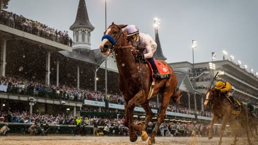 Justify #7 with Mike Smith up wins the 144th Kentucky Derby at Churchill Downs on May 5, 2018 in Louisville, Kentucky.