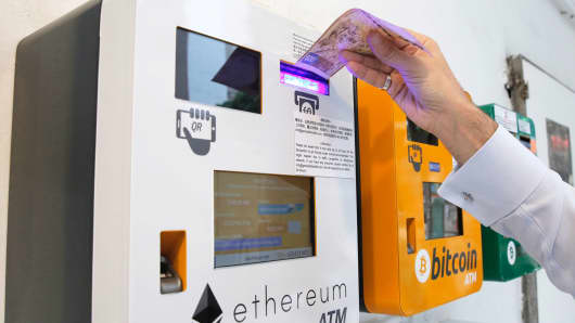 A man uses the Ethereum ATM in Hong Kong, Friday, May 11, 2018.