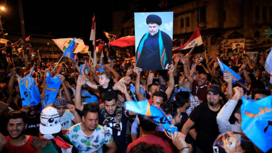 Supporters of Iraqi Shiite cleric Moqtada al-Sadr celebrate the results of the parliamentary election.