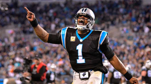 Cam Newton #1 celebrates after a touchdown against the Miami Dolphins during their game at Bank of America Stadium on November 13, 2017 in Charlotte, North Carolina.