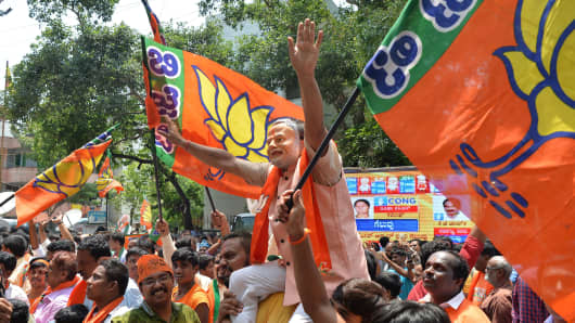 Supporters of India's BJP celebrate election results in front of the party's state office in Bangalore, Karnataka, on May 15, 2018.