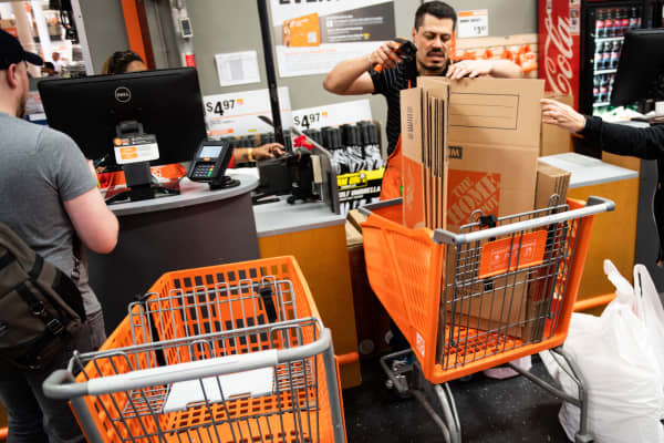 A cashier scans a customers purchases at a Home Depot store in New York.
