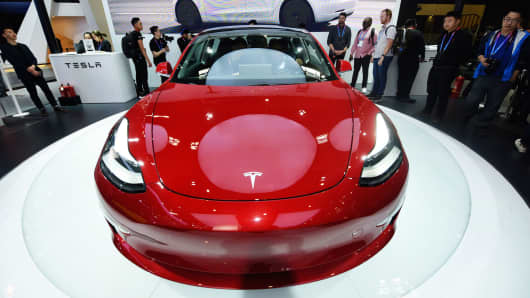 A Tesla Mannequin Three automobile is on repeat throughout the Auto China 2018 at China Global Exhibition Center on April 25, 2018 in Beijing, China.