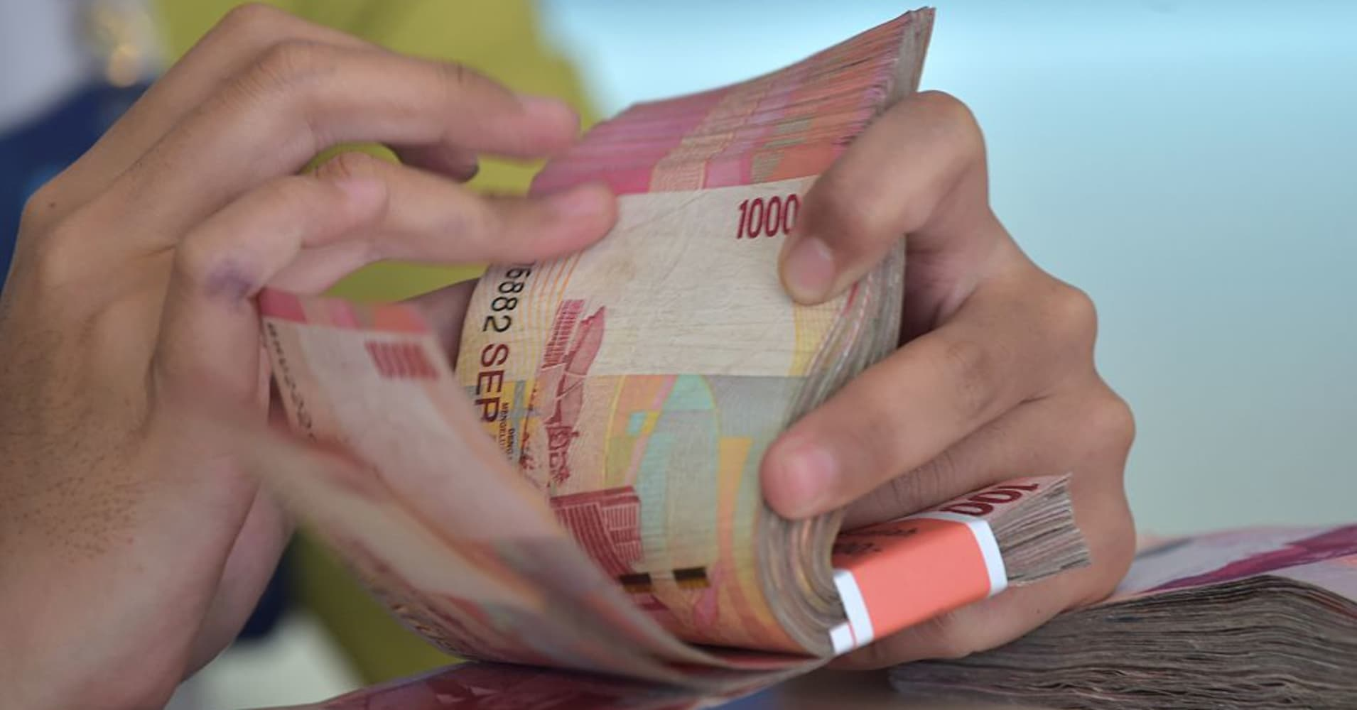 Indonesian rupiah weakens as importers' dollar demand rises, central bank intervenes