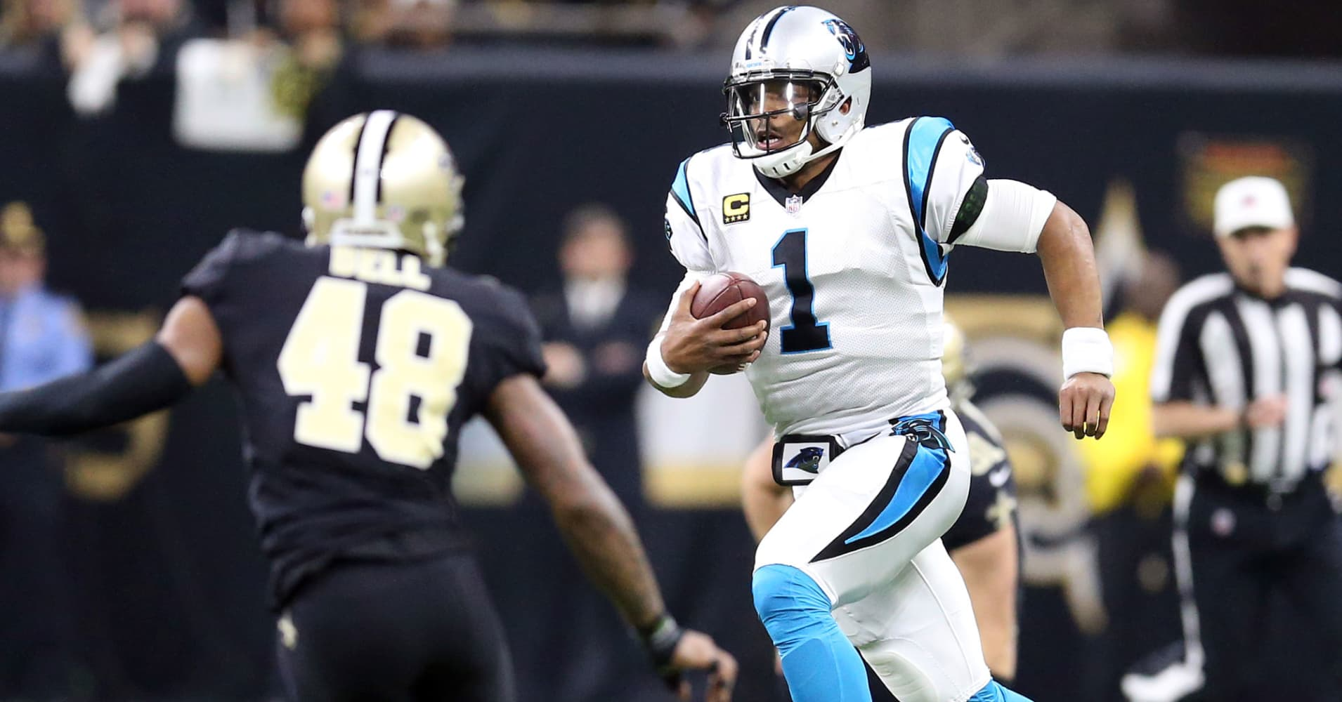 Cam Newton #1 of the Carolina Panthers runs the ball against Vonn Bell #48 of the New Orleans Saints during the first half of the NFC Wild Card playoff game at the Mercedes-Benz Superdome on January 7, 2018 in New Orleans, Louisiana.