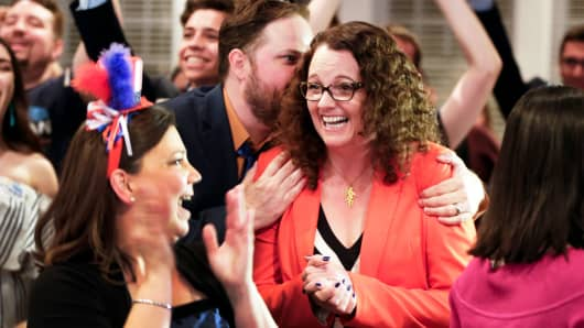 Democratic 2nd District House candidate Kara Eastman is hugged by her campaign manager Ben Onkka, in Omaha, Neb., Tuesday, May 15, 2018, as she holds a slim lead over Brad Ashford in the primary election.