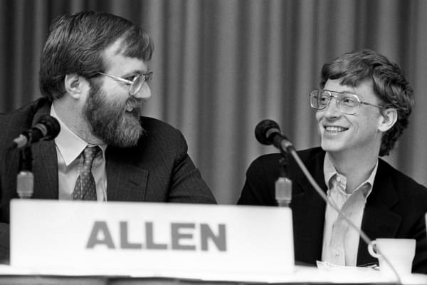 Paul Allen, from Asymetrix Corporation/Vulcan Inc., and Bill Gates, from Microsoft, share a laugh at the annual PC Forum, Phoenix, Arizona, February 22-25, 1987. (Photo by Ann E. Yow-Dyson/Getty Images)