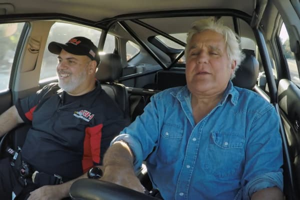 Jay Leno and Nick Filippides riding in the PriuSRT8
