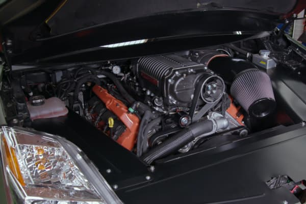 The Dodge Hellcat engine under the hood of the PriuSRT8