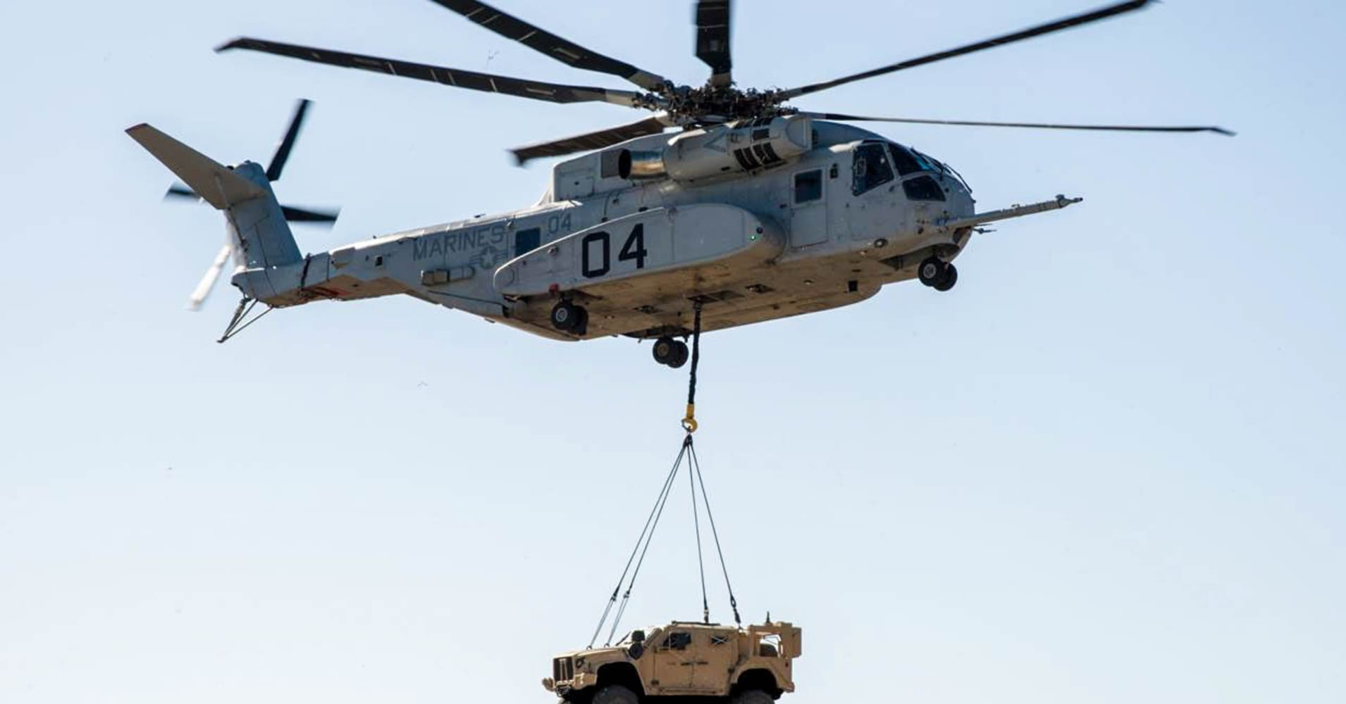 A CH-53K King Stallion lifts a Joint Light Tactical Vehicle during a demonstration on January 18, 2018.