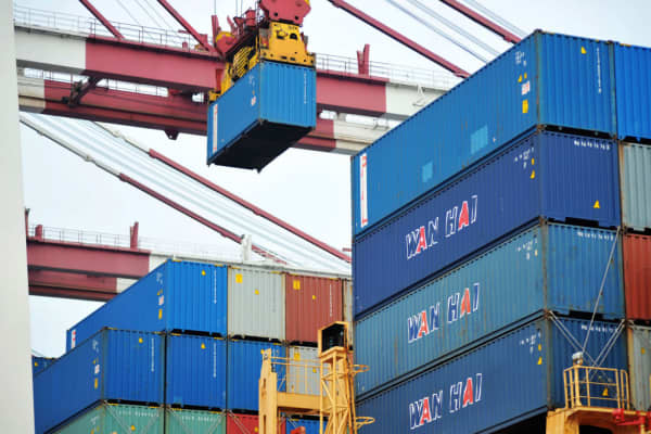 Containers are loaded onto a ship at Qingdao Port on Mar. 8, 2018, in Qingdao, China.