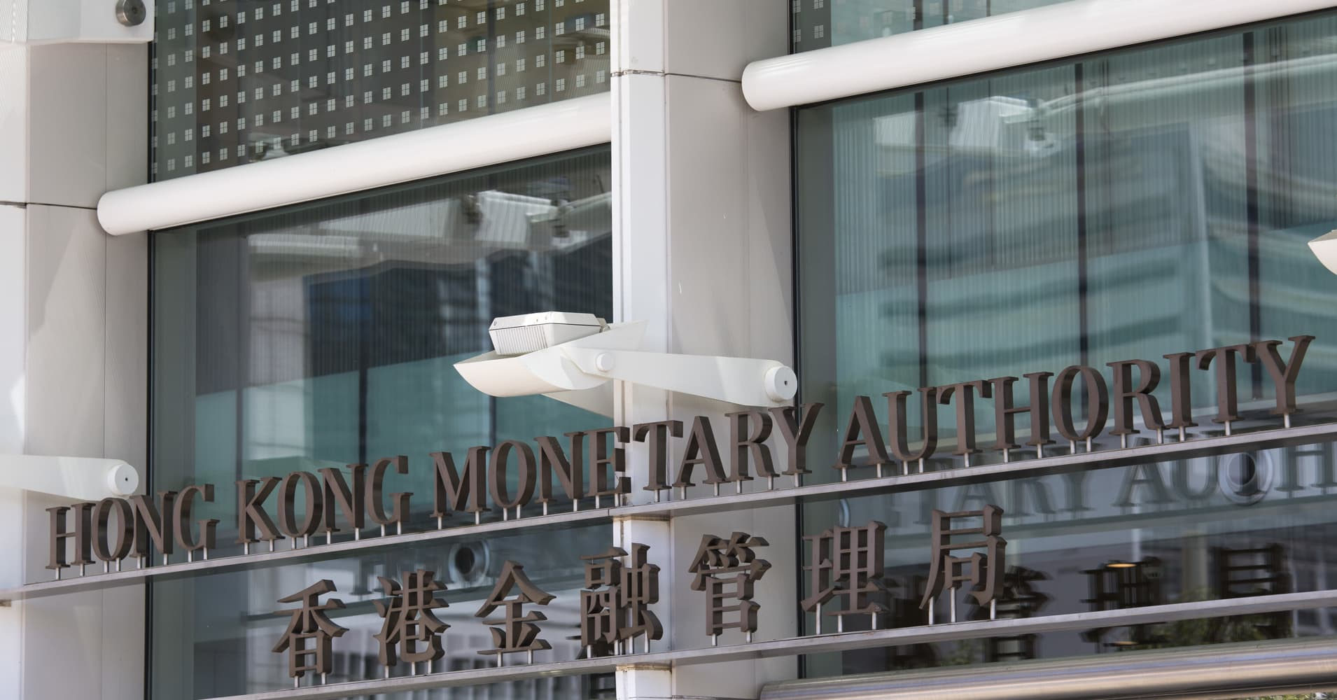 The Hong Kong Monetary Authority is displayed outside Two International Finance Centre in Hong Kong on June 19, 2013.