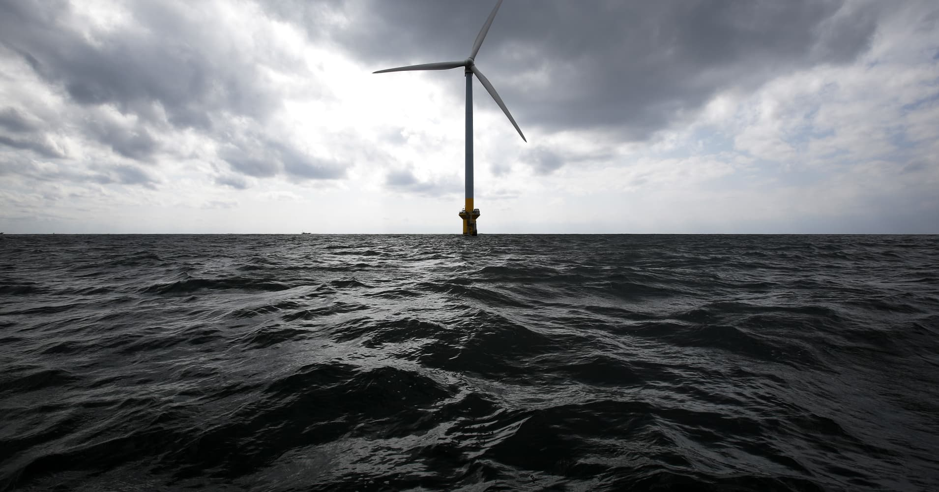 A wind turbine stands in the sea off the coast of Choshi City, Chiba Prefecture, Japan, on Monday, March 4, 2013.
