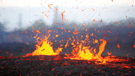 Lava erupts from a fissure on the outskirts of Pahoa during ongoing eruptions of the Kilauea Volcano in Hawaii, U.S., May 14, 2018.