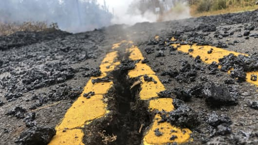 Cracks and volcanic debris are seen on a road in Leilani Estate, Hawaii.