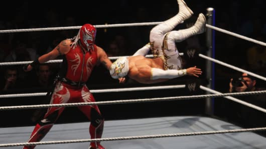 Rey Mysterio competes in the ring against Sin Cara during the WWE SmackDown.