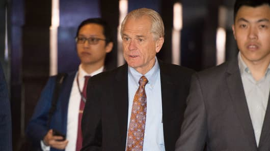 White House economic adviser Peter Navarro (C) walks through a hotel lobby as he heads to the Diaoyutai State Guest House to meet Chinese officials for ongoing trade talks in Beijing on May 4, 2018.