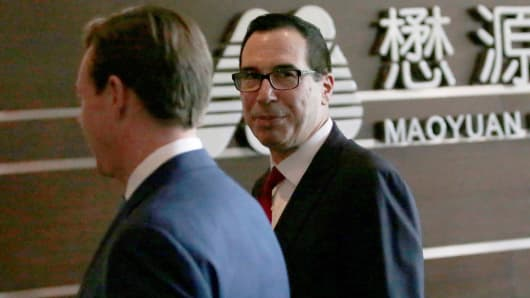 Treasury Secretary Steven Mnuchin (R) is seen as he and a U.S. delegation for trade talks with China arrive at a hotel in Beijing, China May 3, 2018.