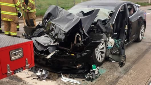In this Friday, May 11, 2018, file photo released by the South Jordan Police Department shows a traffic collision involving a Tesla Model S sedan with a Fire Department mechanic truck stopped at a red light in South Jordan, Utah.