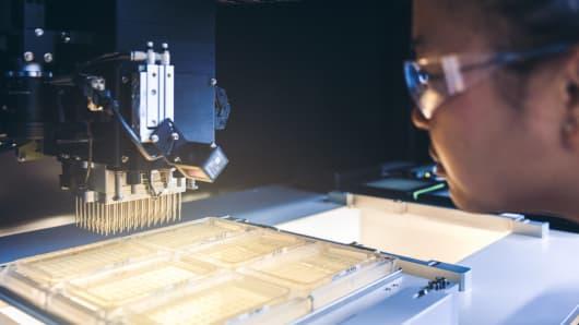 Senior automation engineer optimizing automated lab protocol on colony picker.