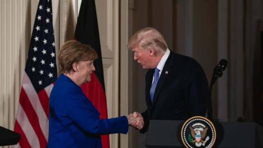 German Chancellor Angela Merkel and U.S. President Donald Trump shake hands during their joint press conference in the White House on Friday, April 27, 2018.