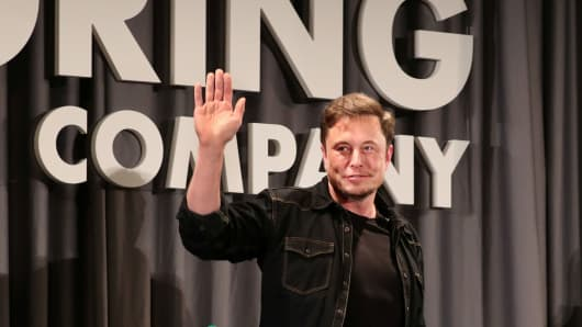 Elon Musk waves after speaking at a Boring Company community meeting in Bel Air, Los Angeles, California, May 17, 2018.