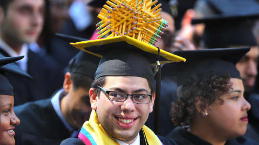 A Massachusetts Institute of Technology Graduate student, who received a degree in civil engineering, wears a pencil sphere on his cap during the MIT commencement at Killian Court on the MIT campus in Cambridge, MA