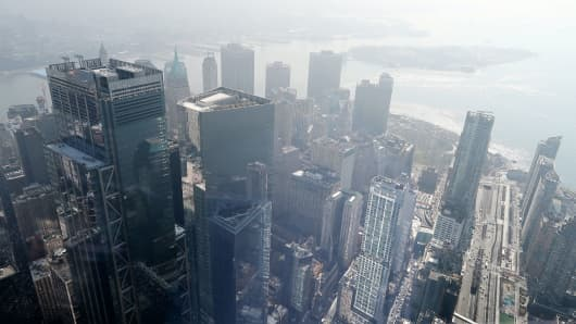 A thick fog lifts over lover Manhattan as seen from One World Observatory in New York City.