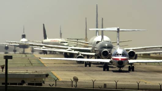 Airliners line up for take off at Los Angeles International Airport in Los Angeles, California.