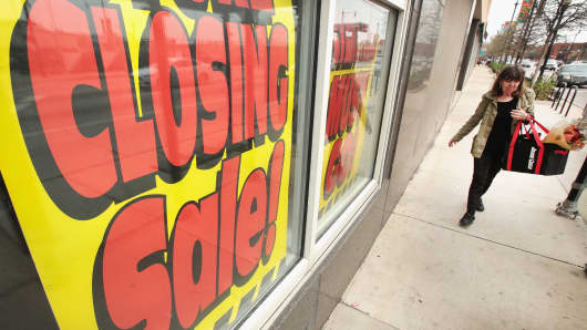 Signs in the window of a Sears store advertise the store's closing on May 3, 2018 in Chicago.