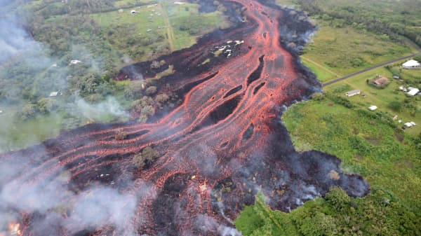 Lava flows downhill, in this image from a helicopter overflight of Kilauea Volcano's lower East Rift zone, during ongoing eruptions of the Kilauea Volcano in Hawaii, U.S., May 19, 2018.