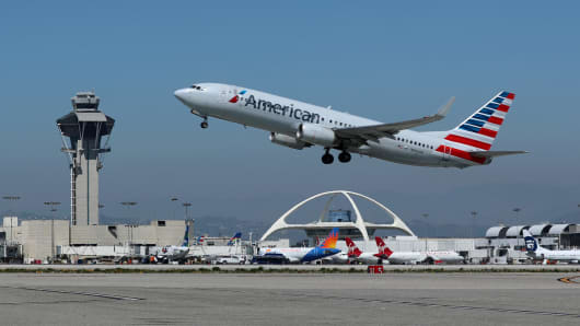 An American Airlines Boeing 737-800 plane takes off from Los Angeles International airport.