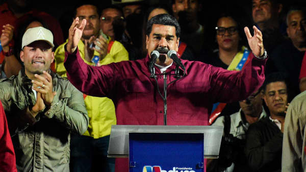 Venezuelan President Nicolas Maduro addresses supporters after the National Electoral Council (CNE) announced the results of the voting on election day in Venezuela, on May 20, 2018 in Caracas.