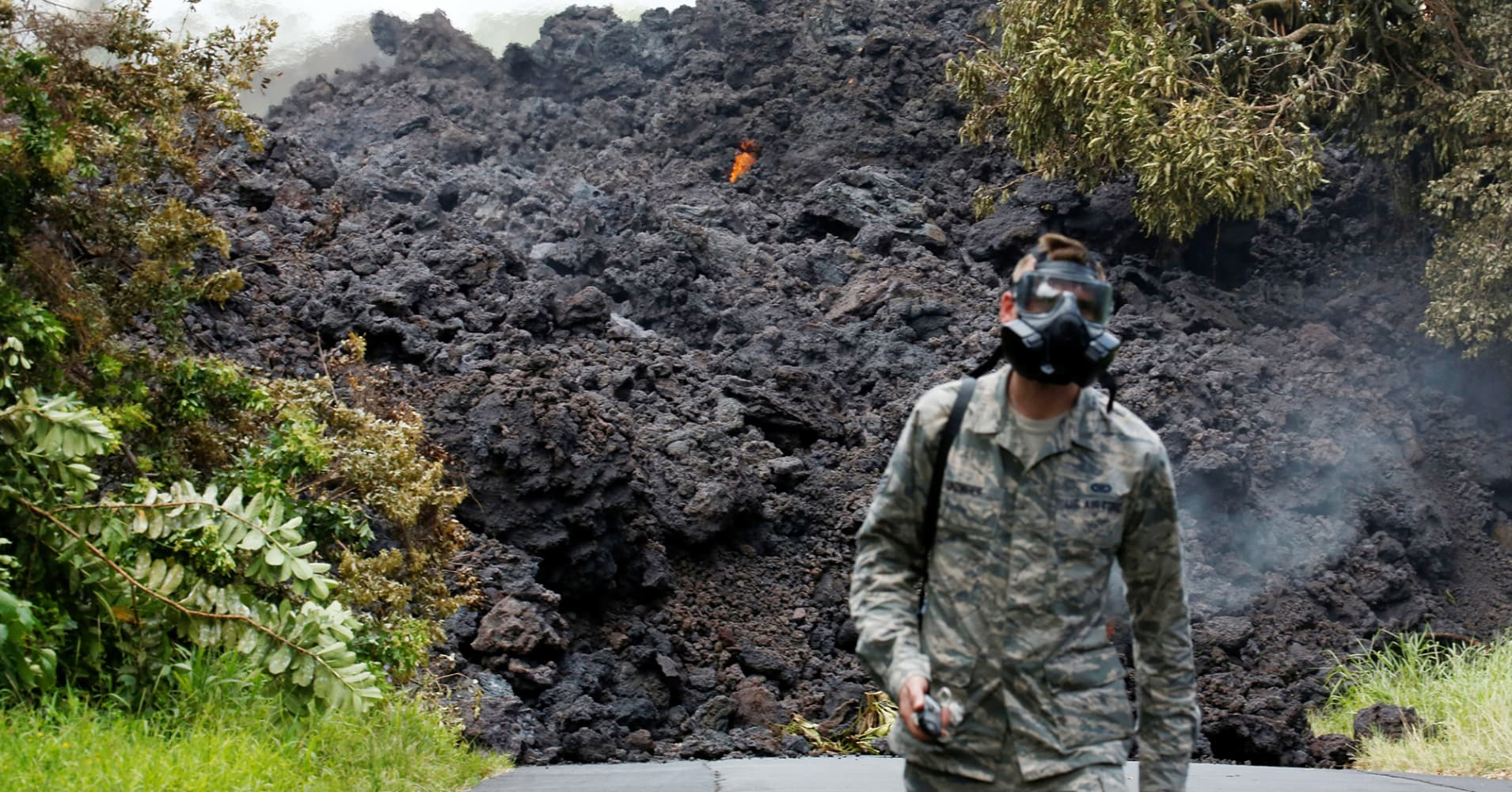 Senior Airman John Linzmeier, of the Hawaii National Guard, walks away from a lava flow on Highway 137 southeast of Pahoa during ongoing eruptions of the Kilauea Volcano in Hawaii, U.S., May 20, 2018.