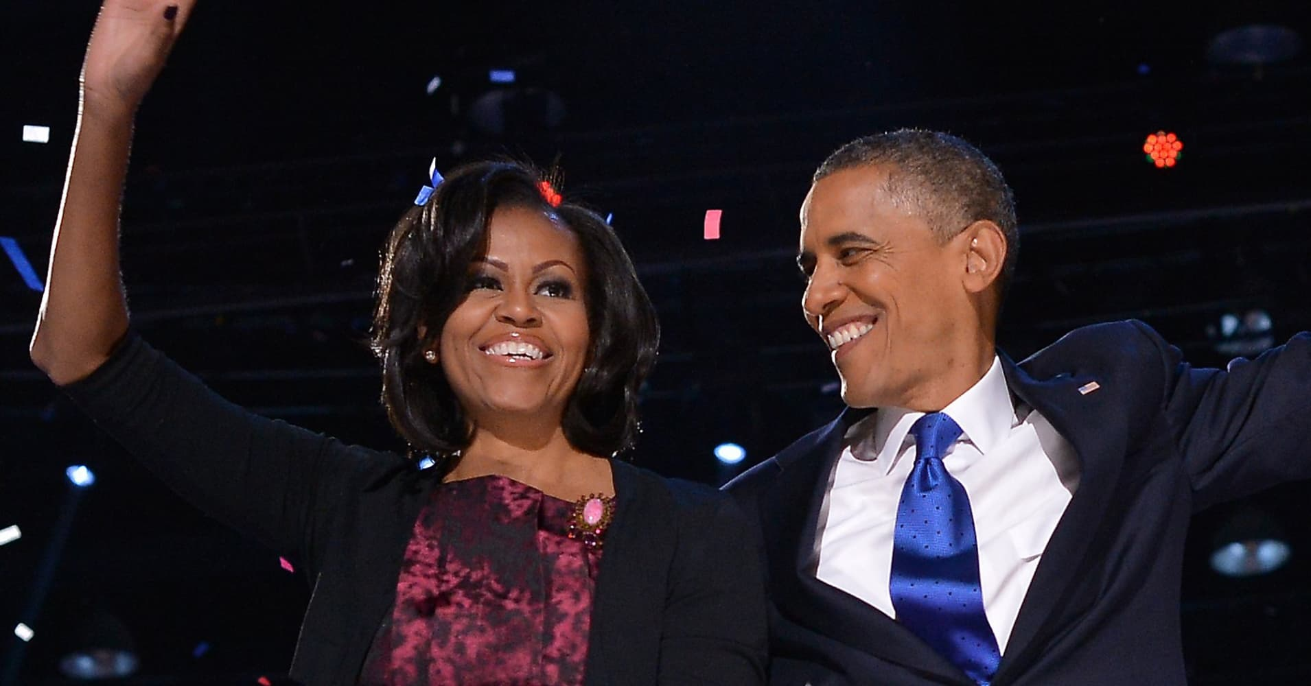 US President Barack Obama celebrates on stage with his wife Michelle after delivering his victory speech ion Chicago on November 7, 2012.