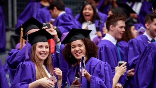 Graduating students wait for the start of New York University's commencement ceremony at Yankee Stadium, May 16, 2018 in the Bronx borough of New York City.
