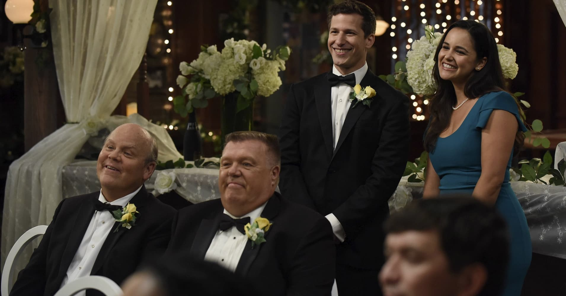 "Dirk Blocker as Hitchcock, Joel McKinnon Miller as Scully, Andy Samberg as Jake Peralta and Melissa Fumero as Amy Santiago in ""Brooklyn Nine-Nine."""