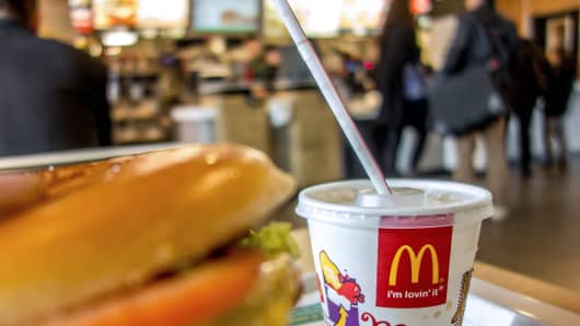 A container with a drink is served at the McDonald's fast-food outlet.