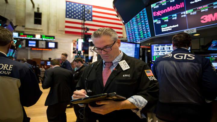 Stocks pull back, Dow slides triple digits