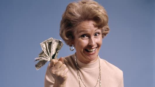 1970s happy lady with money
