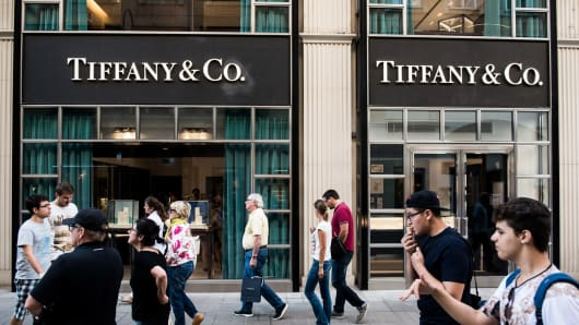 Pedestrians pass in front of a Tiffany & Co. store.