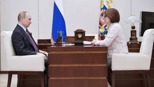 Russia's President Vladimir Putin (L) and Russian Central Bank Governor Elvira Nabiullina