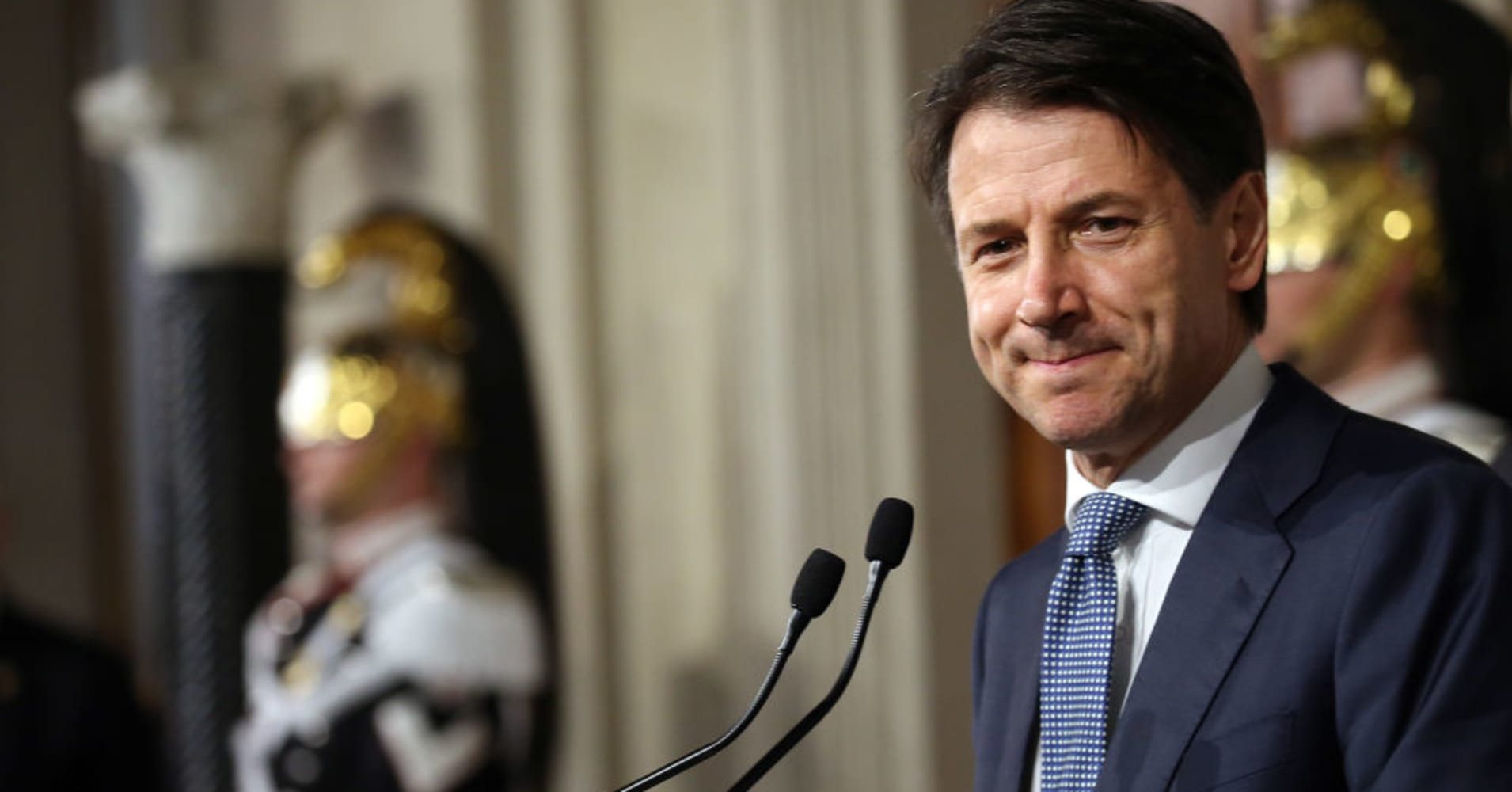 Italy sees anti-establishment government sworn in after roiling global markets