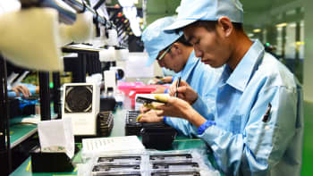 Employees work on the North America project line of smartphone at a workshop of ZTE Corp. on July 26, 2016 in Xi an, China.
