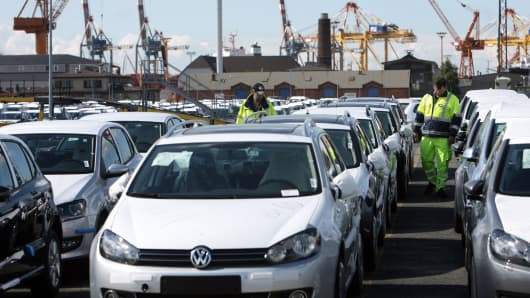 Employees of German logistic company BLG Logistics Group AG control rows of German Volkswagen cars at the car terminal at the harbour of Bremerhaven, Germany.