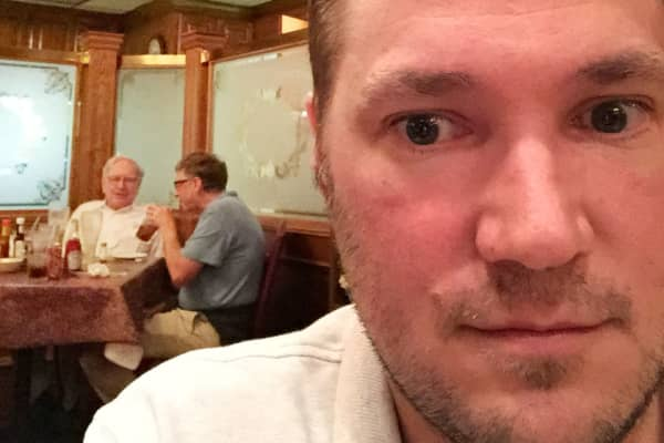 Selfie of Omaha resident Ryan Basye with billionaires Warren Buffett and Bill Gates at Piccolo Pete's.