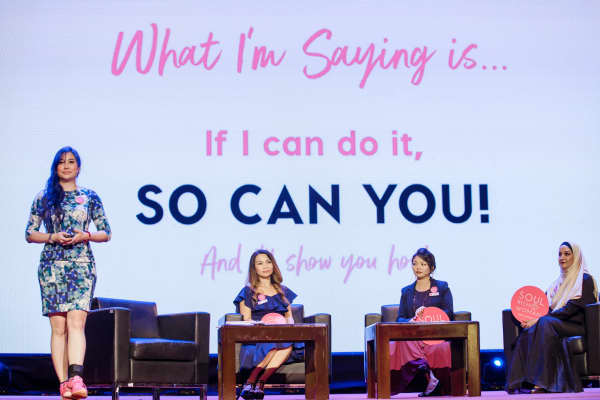 Genecia Alluora, founder of Soul Rich Woman presents with panelists in Hanoi