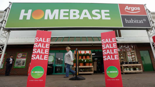 A customer leaves a Homebase store, part of Home Retail Group Plc, in Sevenoaks, U.K., on Wednesday, Jan. 6, 2016. U.K. grocer J Sainsbury Plc plans to buy Walmart Inc.s Asda in a 7.3 billion-pound ($10 billion) deal that would transform the countrys supermarket industry and leave the U.S. retailer as the combined companys biggest shareholder. Our editors select the best archive images of the two supermarket chains.