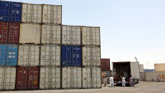 Iranian workers transfer goods from a cargo container to trucks at the Kalantari port in city of Chabahar on May 12, 2015. Chabahar, located on the coast of Sistan-Baluchistan (south-east), is open to the Oman Sea and the Indian Ocean. It is Iran's gateway to Pakistan and Afghanistan in the east, the Central Asian countries to the north, and Turkey and the Gulf countries in the west.