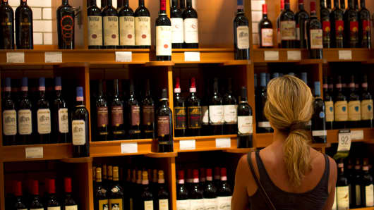 A woman shops for wine in Canada.